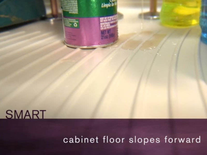 This Clever Cabinet Slopes Forward To Make Cleaning Spills Fast And Easy