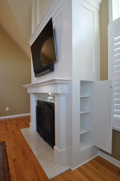 Ordinaire Convenient Hidden Storage Cabinets Tucked Into The Sides Of The Fireplace  By Drumm Design Remodel
