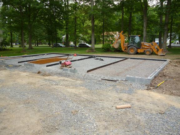 Gravel And Rebar Being Laid Prior To Pouring The Concrete