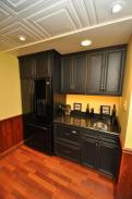 The elegant black wet bar cabinets with new refrigerator