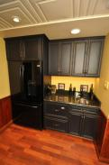 Check out the decorative ceiling and flooring around this wet bar