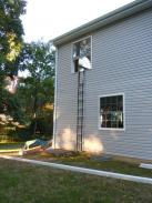 Testing new fire escape installed by Drumm Design Remodel