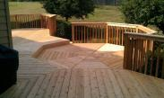 This octagonal step down deck space is the centerpiece of this spectacular deck