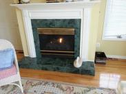 The fireplace before Drumm Remodeling was a standard builder grade fireplace with little impact