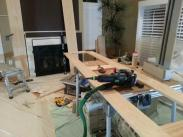 Cabinet frames and base trim being put together on table