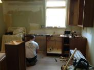 Kitchen cabinets being installed by the Drumm Design Remodel team