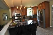 New kitchen cabinets, granite countertops, backsplash and stainless steel appliances