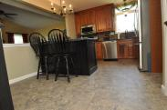 View of new tile floor installed by Drumm Design Remodel