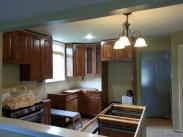 Kitchen cabinets beinf installed by Drumm Design Remodel