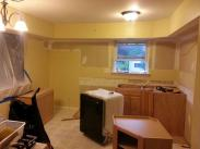 Removing old cabinets and appliances before remodeling by Drumm Design Remodel