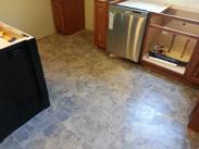 New tile kitchen floor installation by Drumm Design Remodel