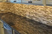 Under cabinet lighting help the chef see their work space easier and show off this elegant backsplash
