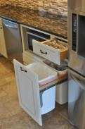 Convenient silverware drawers and hidden space for trash and recycling
