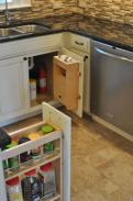 Another view of the spice rack and under sink storage