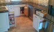Multiple places for clever and convenient storage in this kitchen help the homeowner maximize their space