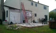 After demolition of the old sunroom Drumm Design Remodel closed off the house to keep the weather out, while we worked