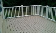 A beautiful deck with a sturdy railing system by Drumm Design Remodel