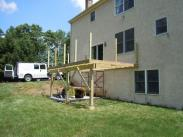 Drumm Design Remodel poured new silo footings and a patio before framing of this deck began