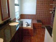 New granite counter tops, and decorative tile throughout this redesigned bathroom