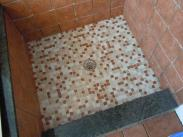 Check out the tile in this shower base, it pulls the color scheme together nicely