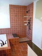Check out this shower, featuring custom tile work, granite accents, and a beautiful shower base