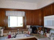 The kitchen, before Drumm Design Remodel, featured a soffit above the cabinets that did not quite follow the cabinet lines for sure