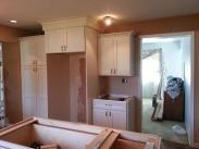 Cabinets going in and shown is the space for the new refrigerator