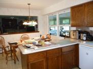 The L-Shaped counter was removed by Drumm Design Remodel in favor of a center island
