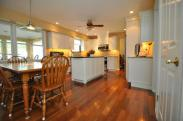 Check out these beautiful floors they not only accent with the cabinets nicely, but they unify the entire space