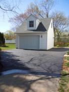 Lots of room in this garage and a great looking dormer ties it into the existing home's styling
