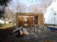 The base of the garage is enclosed, now to get to work on the attic and roof