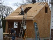 Plywood sheets going up on the roof