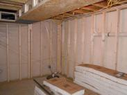 Another view of the framing and insulation, plus Drumm Design Remodel adds a vapor barrier to make your basement more energy efficient