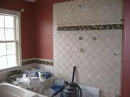 The new tile being installed and ready for grouting