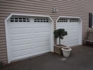 The newly installed Drumm Design Remodel aluminum garage doors with windows look fantastic