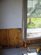 Removing the rot and supporting the structure with a jack