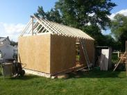 A view of the shed from the back being framed up