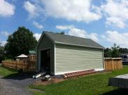 The exterior of the shed with new siding and a lot more space for family storage