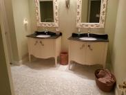 Double vanities simply did not provide enough storage space and the mirrors made the room feel smaller
