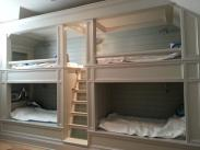 This bunkroom needed more storage space and upgraded lighting fixtures