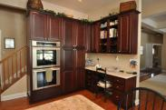 A built-in double oven and corner office space really upgraded this roomy new kitchen by Drumm Design Remodel