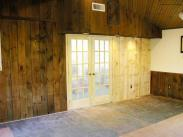 Drumm Design Remodel installed new french doors and replaced old rotted wood paneling in this addition