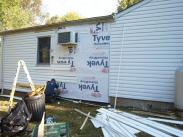 Drumm Design Remodel installed a new vapor barrier and replaced the siding so that the home looked good as new
