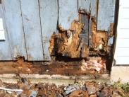 Water damage caused this sil and paneling to rot away, making the room structurally unsound