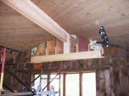 Drumm Design Remodel then replaced the old beam with an engineered support beam that was much stronger and distributed the roof load better