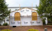 The new vapor barrier is installed and arched windows are ready to go into this family room