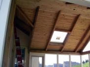 Loving this exposed beam tongue and groove ceiling and skylight