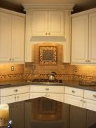 A view of the custom tile backsplash and range hood by Drumm Design Remodel