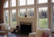 A view of the wall of windows and awesome fireplace