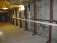 After the gaps between the steel beams and walls were filled with concrete by Drumm Design Remodel
